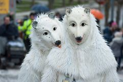 Portrait of people with wolf costumes parading in the street royalty free stock images