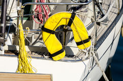 PFD at yacht aft. Yellow personal flotation device no yacht Stock Image