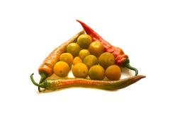 Pfeffer und gelbe Tomaten Stockbilder