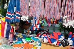 Pfeifen und drei-farbige Bänder der Staatsflagge stockfoto