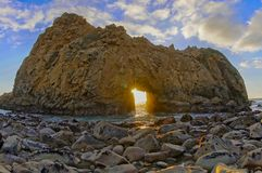 Pfeiffer Beach Keyhole Rock. Taken in wintertime, when the sun beams through the keyhole. Pfeiffer Beach in Big Sur, Monterey County, California, USA Stock Photo