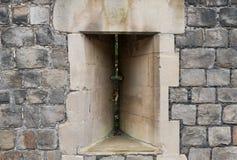 Pfeil aufgeschlitzt in der Windsor Castle-Wand Stockbild