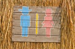 Pfeile zeigen die Toilette an. Lizenzfreie Stockbilder
