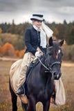Pferd-Jagd mit Reitern in der Reitgewohnheit Stockbilder