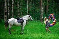 Pferd und Frau Stockfotos