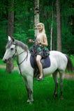 Pferd und Frau Stockbild