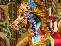Pferde auf einem Karussell Stockfotografie
