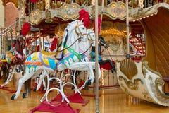 Pferde eines Karussells Stockfotografie