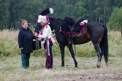Pferdereiter an der historischen Wiederinkraftsetzung Borodino-Kampfes in Russland Lizenzfreie Stockfotografie