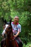 Pferderuecken-Reiten Stockfotos