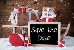 Pferdeschlitten mit Geschenken, Schnee, Schneeflocken, englische Text-Abwehr das Datum Stockfotografie