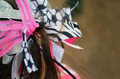 Pferdeschwanz mit Band Stockfotografie