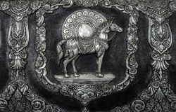 Pferdeskulptur auf der Tempelwand Lizenzfreies Stockfoto