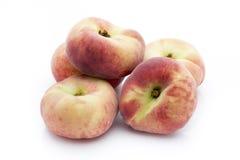 Pfirsich auf dem weißen isolatd Hintergrund Stockfotografie