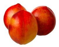 Pfirsich getrennt auf einem weißen Hintergrund. Stockfotografie