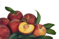Pfirsiche und Blätter Lizenzfreies Stockbild