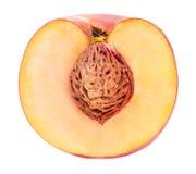 Pfirsichfrucht geschnitten lokalisiert auf weißem Hintergrund Lizenzfreies Stockfoto