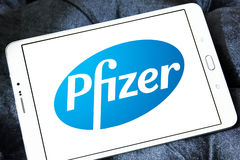 Pfizer logo. Logo of pharmaceutical company pfizer on samsung tablet stock images