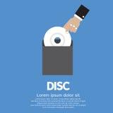 Pflücken Sie herauf eine CD mit der Hand Lizenzfreies Stockbild