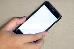 Pflücken Sie herauf intelligentes Telefon mit der Hand Lizenzfreie Stockfotografie
