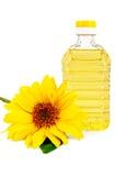Pflanzenöl mit einer Blumensonnenblume Lizenzfreie Stockfotos