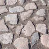 Pflastersteinoberfläche als abstrakter Hintergrund stockfotografie