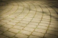 Pflasterung ausgebreitet in einem Halbrund von glatten Steinen Pflasterung von ston Stockfoto