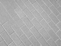 Pflasterung deckt Hintergrund mit Ziegeln Stockfoto