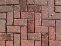 Pflasterung des roten Ziegelsteines Stockbild