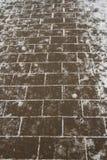 Pflasterung im Schnee Lizenzfreies Stockfoto