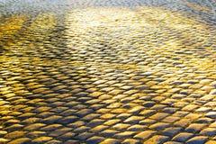 Pflasterung von Fliesen in der Sonne Lizenzfreies Stockfoto