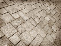 Pflasterungs-Hintergrund von Kopfsteinsteinen Lizenzfreie Stockfotos