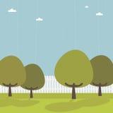 Pfostenzaun mit Bäumen Lizenzfreies Stockbild