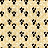 Pfotenabdrücke auf einem schönen Hintergrund vector nahtloses Muster Stockbilder