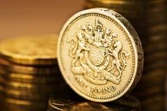 Pfund GBP-Münze und Goldgeld Stockfoto