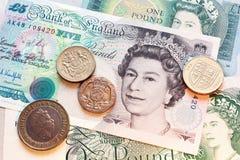 Pfund, Münze und Banknote Stockbilder