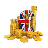 Pfund-Symbol und Goldmünzen Stockfotografie