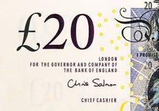 Pfundwährungshintergrund - 20 Pfund Stockbild