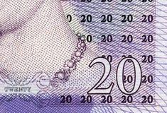 Pfundwährungshintergrund - 20 Pfund Lizenzfreie Stockfotos