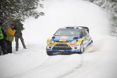 PG Andersson. RADA, SWEDEN - FEB 10: Per-Gunnar Andersson driving his Ford Fiesta WRC during WRC event Rally Sweden 2011 in Rada, Sweden on Feb 10 , 2011 Stock Photo
