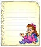 Página del cuaderno con la colegiala Imagen de archivo