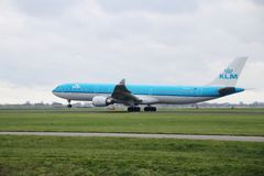 PH-AKA KLM Royal Dutch Airlines Airbus A330-303 is departing from Polderbaan. 18R - 36L on Amsterdam schiphol airport in the Netherlands royalty free stock photography