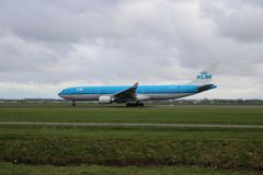 PH-AKF KLM Royal Dutch Airlines Airbus A330-303 is departing from Polderbaan 18R - 36L. On Amsterdam schiphol airport in the Netherlands royalty free stock photo