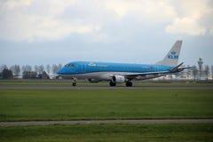 PH-EXL KLM Cityhopper Embraer ERJ-175STD is departing from Polderbaan. PH-EXL KLM Cityhopper Embraer ERJ-175STD is departing from Polderbaan 18R - 36L on stock image