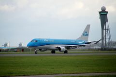 PH-EXP KLM Cityhopper Embraer ERJ-175STD is departing from Polderbaan. 18R - 36L on Amsterdam schiphol airport in the Netherlands royalty free stock image