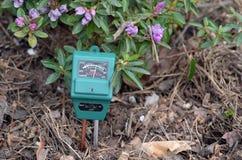 PH-meter in the garden. Soil moisture, light and PH meter royalty free stock image
