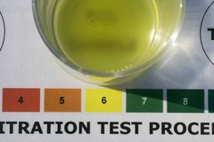 Ph test of biodiesel. This Ph is before washing, slightly higher Ph shows biodiesel is more acid it will still run in any diesel engine but may damage it stock photography