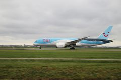 PH-TFK TUI Airlines Netherlands Boeing 787-8 Dreamliner is departing from Polderbaan. 18R - 36L on Amsterdam schiphol airport in the Netherlands royalty free stock photos