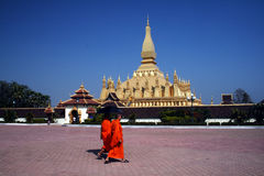 Pha that luang. Two monks are crossing the square in front of the golden stupa of pha that luang in vientiane.january 2009 Stock Image