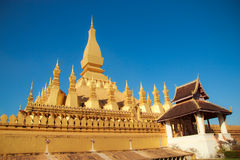 Pha That Luang with blue sky at Laos Stock Photos